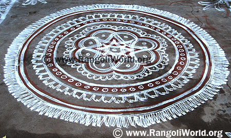 Two stroke Freehand Rangoli with white and maroon color pooja circle