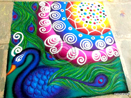 Colorful peacock freehand rangoli for holi festival 2015