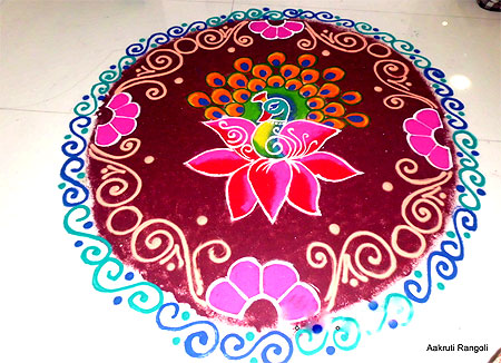 Peacock with lotus rangoli for holi festival 2015