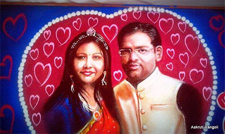 Perfect couple freehand portrait rangoli 2015