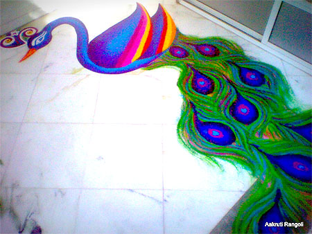 Single peacock rangoli for holi festival 2015