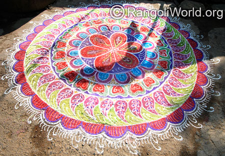 Big freehand festival rangoli with mango shapes mar