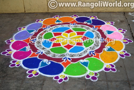 Colourful floral freehand margazhi rangoli 2017