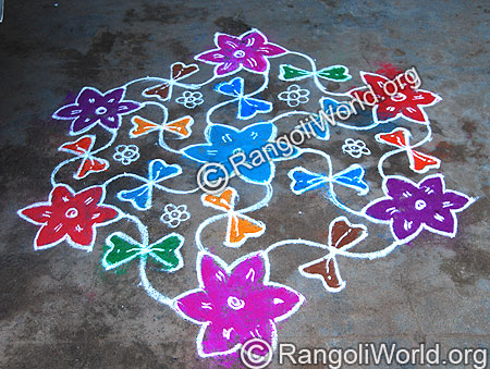 Flowers and zigzag combining lines kolam